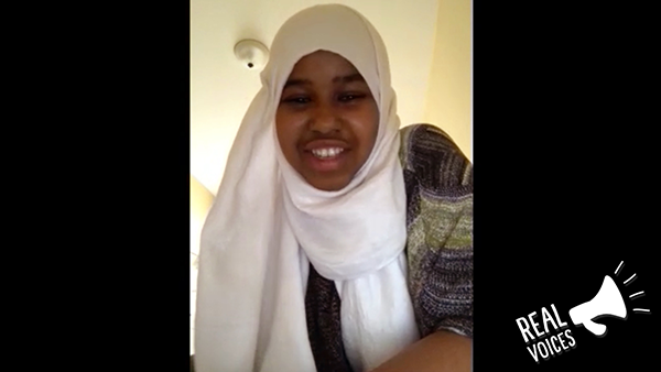Young woman in hijab discussing issues